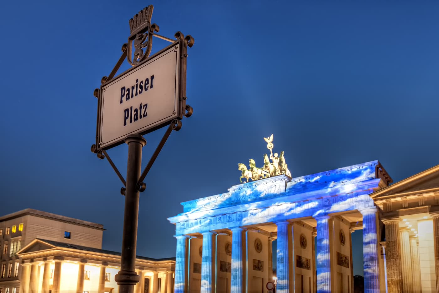 Brandenburg Gate covered in clouds. A display on the famous Berlin sight during the Festival of Lights 2013