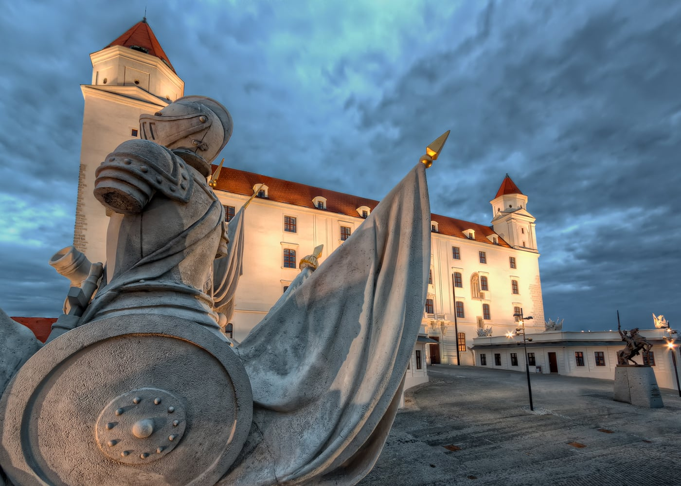 Bratislava Castle with a Roman Statue on the Gate in Front. HDR effect gives a feeling of a haunted castle in Slovakia, guarded by the soldiers at night.