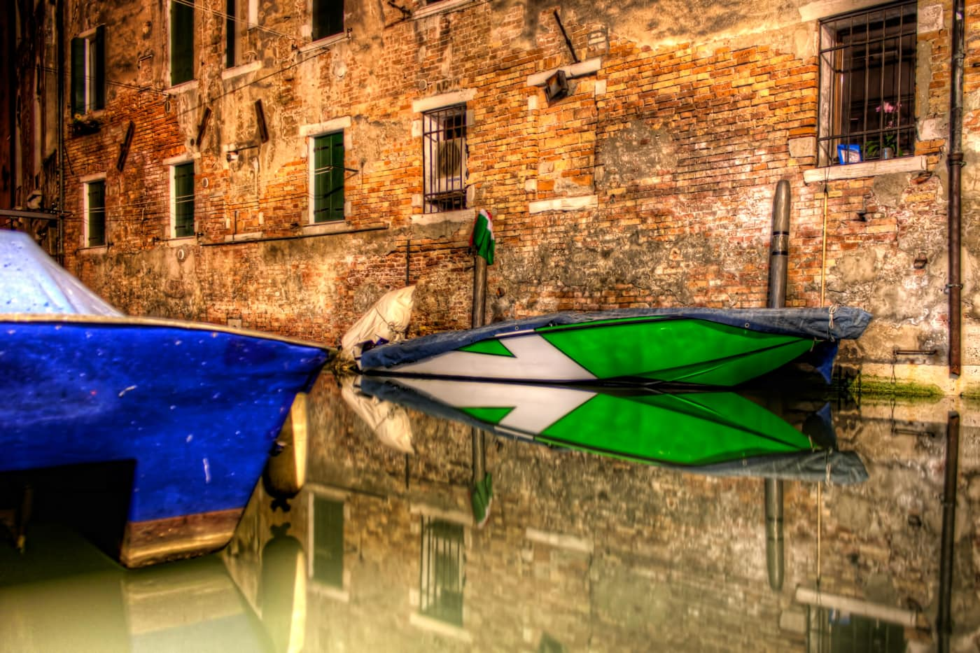 Speed Boat at night in the Venetian Ghetto in Venice, Italy.