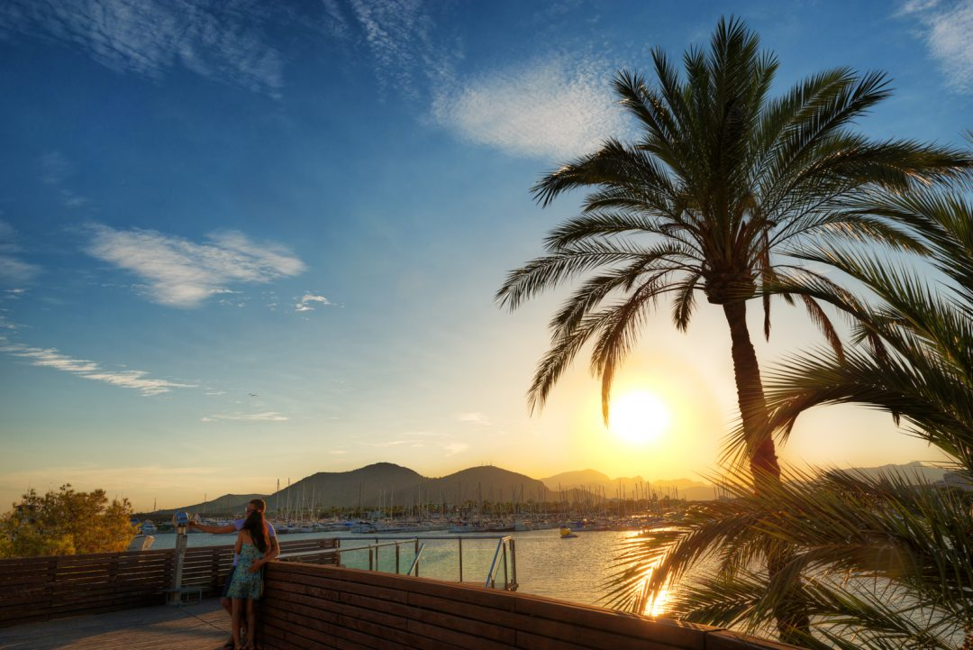 Romantic sunset with a couple in Alcudia on Mallorca in Spain