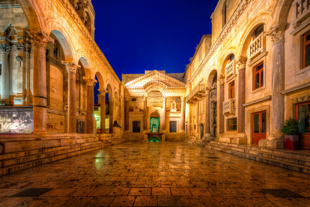 Diocletian's Palace in Split, Croatia at night with stars overhead.