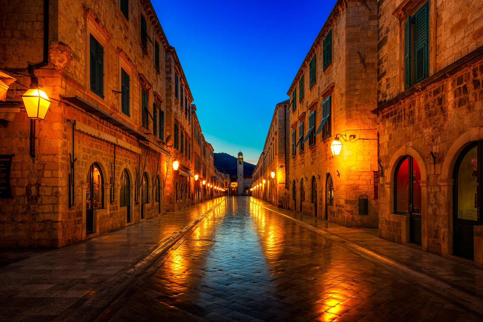The main street Stradun and bell tower in Dubrovnik, Croatia at night.