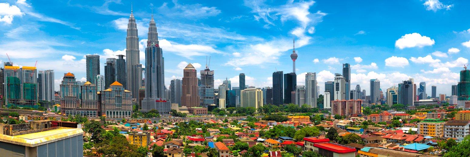 Skyline of Kuala Lumpur with Kampung Baru, Malaysia on a sunny day.