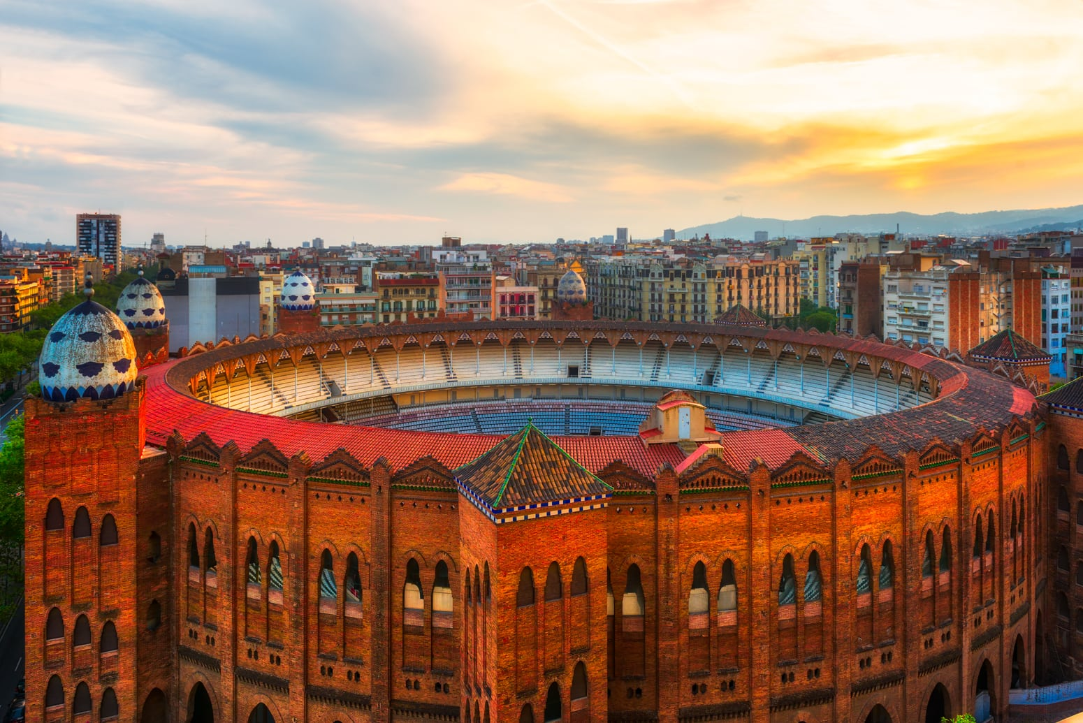 "Bullfighting arena ""La Monumental"" in Barcelona, Spain seen from above with surrounding houses of Eixample district"
