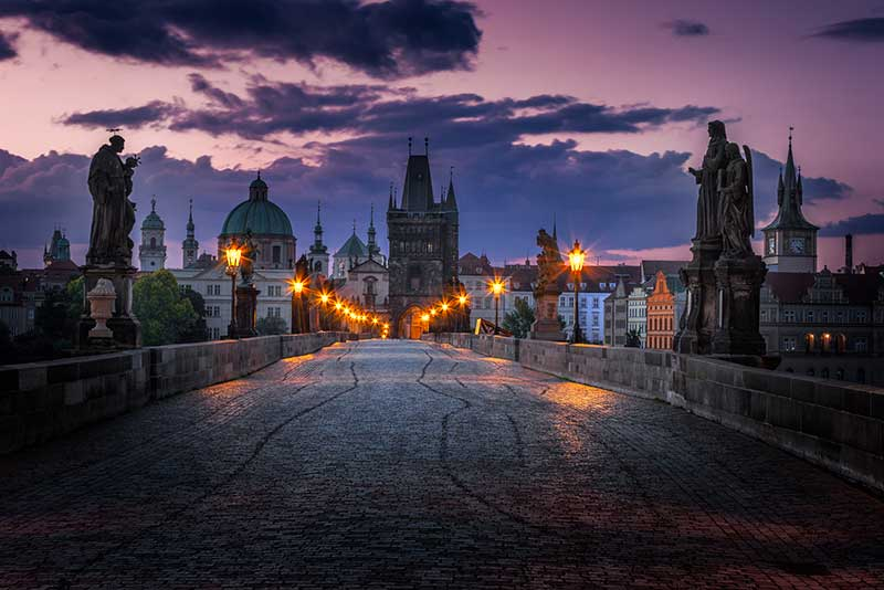 The Charles Bridge in Prague, Czech Republic in the light of the early morning, before sunrise.