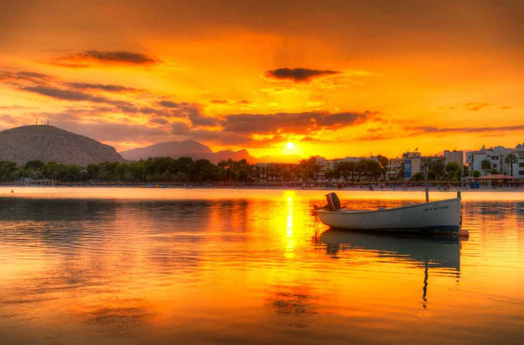 Port D'Alcudia in Mallorca, Spain at sunset. Perfect holiday at historic bay.
