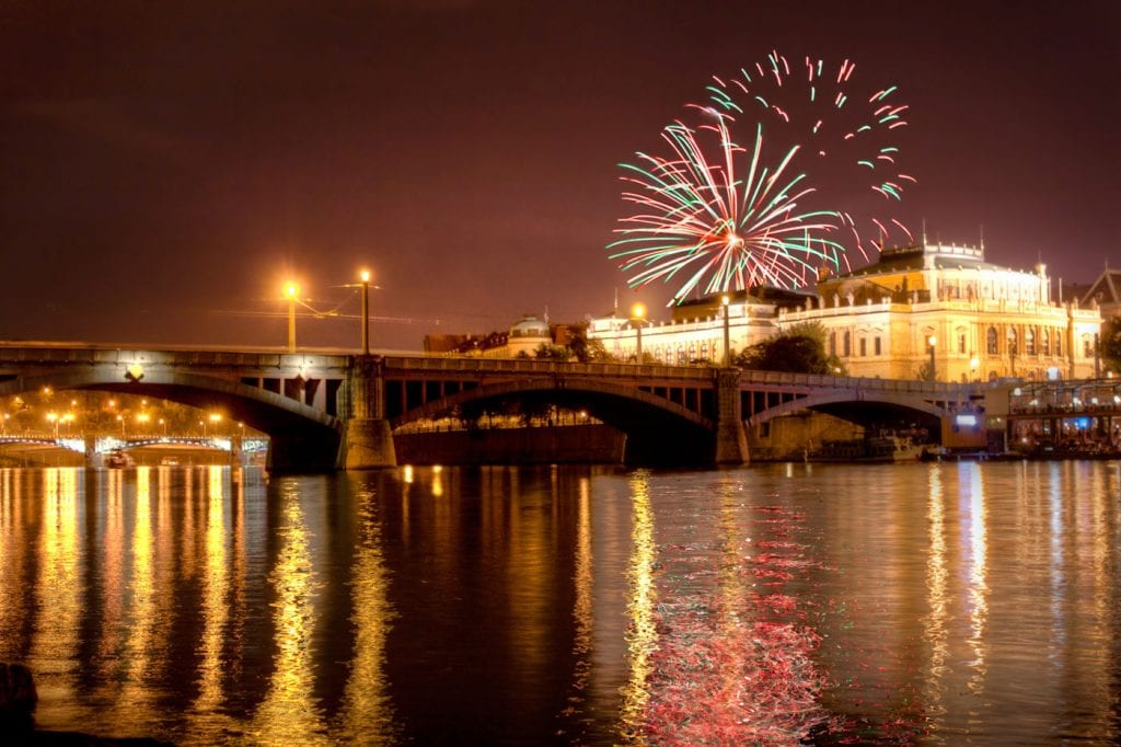 Fireworks over the Rudolfinum in Prague making it look like New Year's Eve in the Czech city at Vltava river.