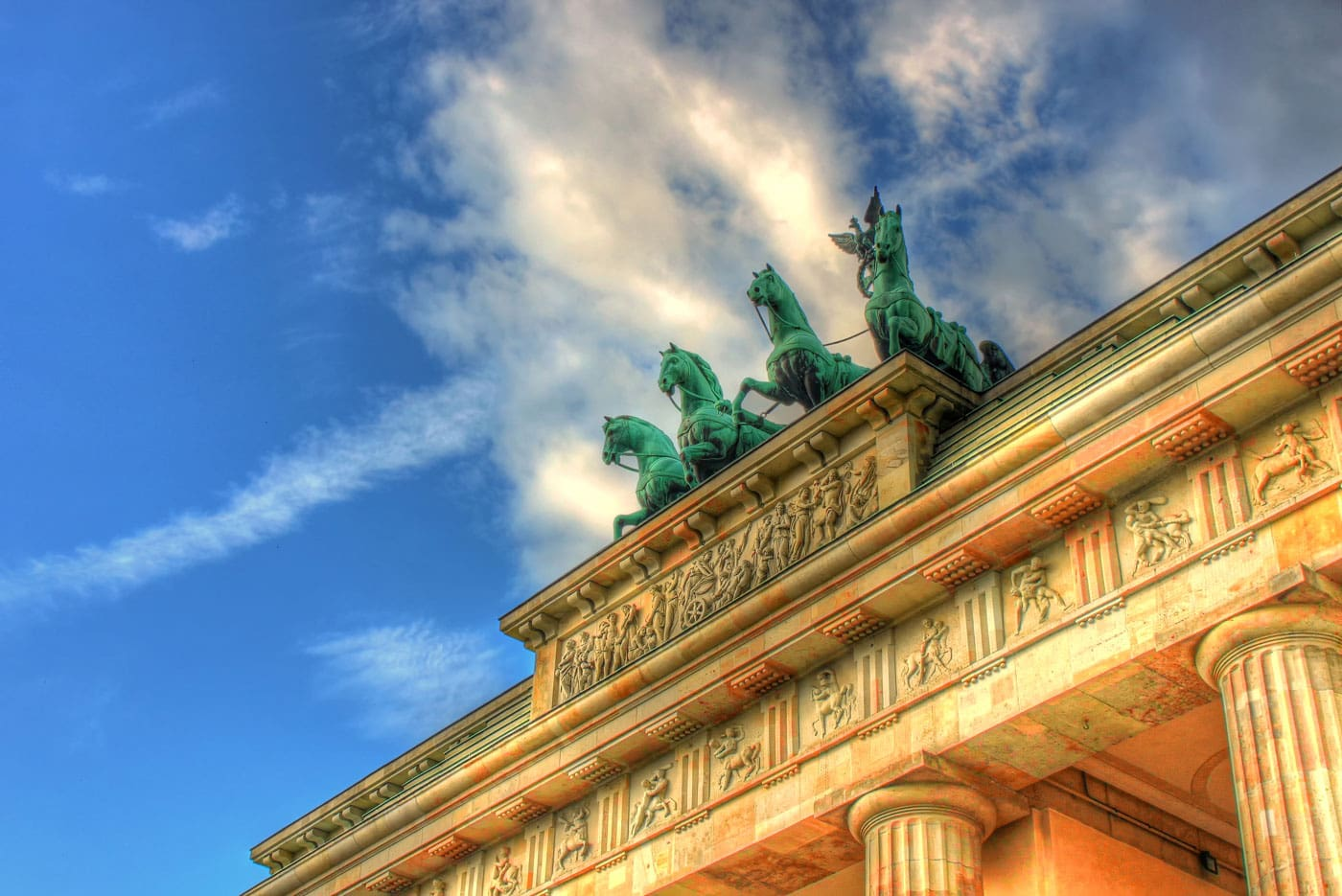 Quadriga on Brandenburg Gate in Berlin with blue sky and clouds