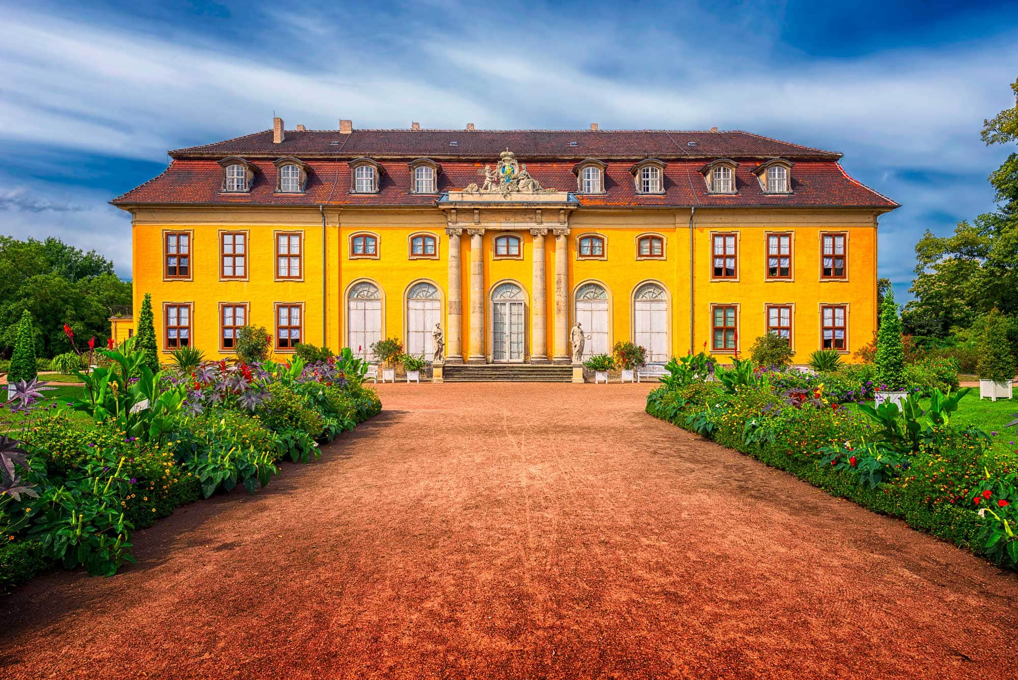 Mosigkau palace in Dessau (Germany) with surrounding gardens and clouds