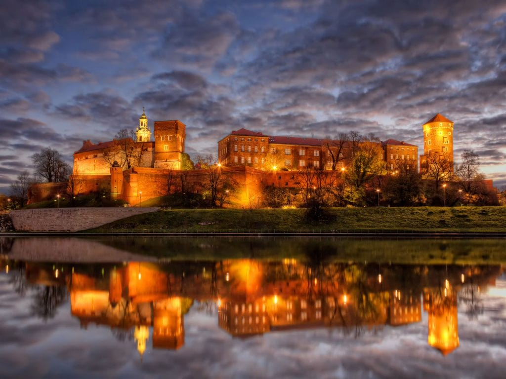 The Wawel Castle in Kraków enlightened at night. HDR Photo taken just before sunrise from the opposite side of the Vistula