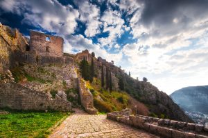Kotor Venetian Fortress ruins with blue sky and clouds