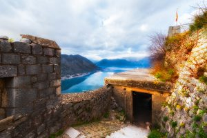 Daytime view to Kotor Bay with focus on Kotor Fortress ruins.