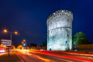 Night photo of Thessaloniki White Tower and the light trails along Leof. Nikis Street.