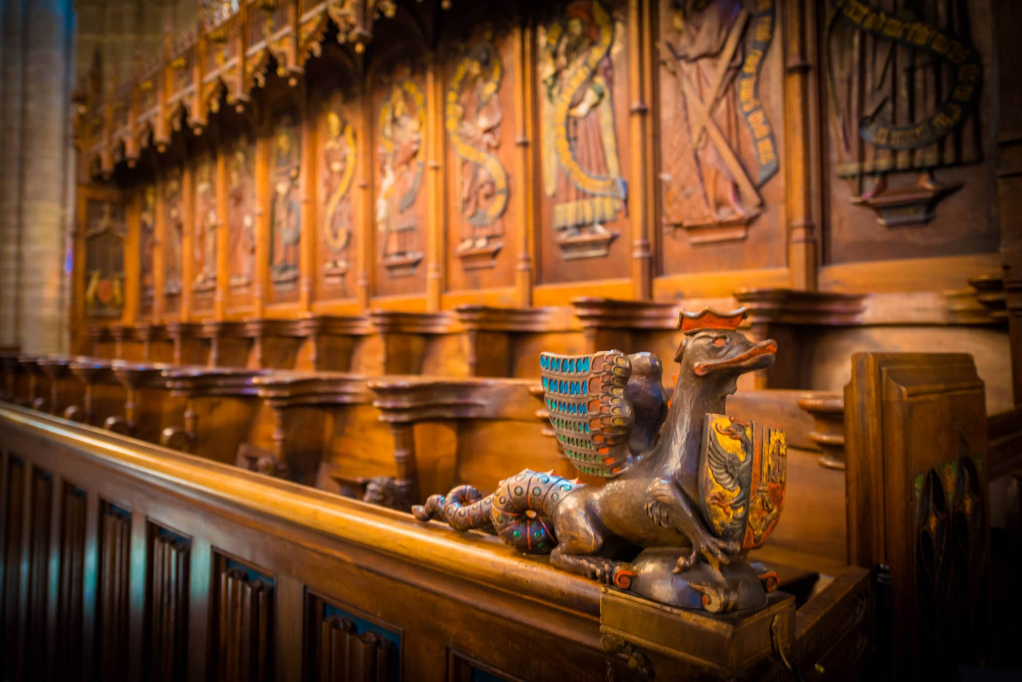 This is a wooden figurine of a small dragon, found in the ancient St. Pierre Cathedral in Geneva.