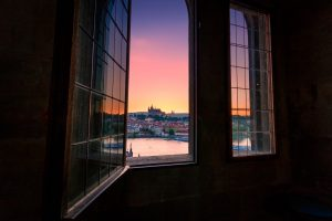 Photo of the Prague Castle during summer sunset taken from Tower of Charles Bridge in Prague, Czech Republic.