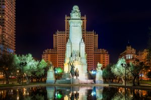 Cervantes monument with Don Quixote and Sancho Penza in the Plaza de España in Madrid during the night.