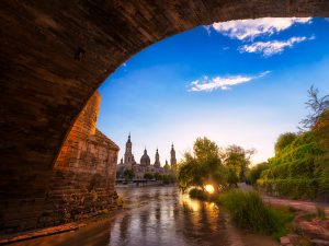 El Pilar Cathedral with The Ebro River during a sunset in Zaragoza, Spain.