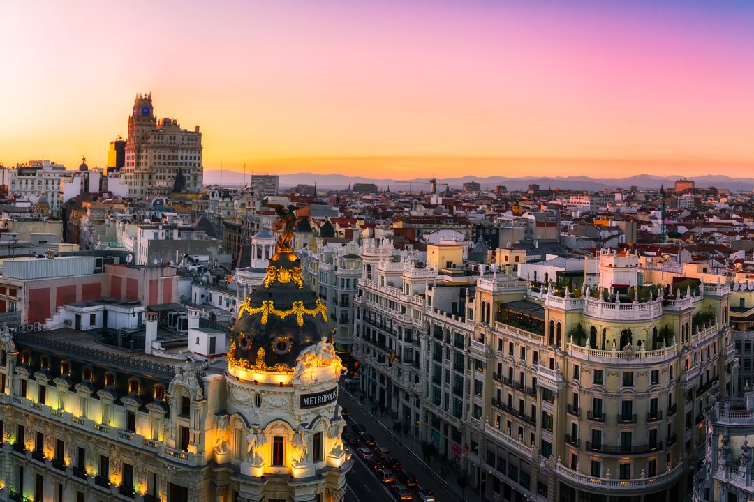 Sunset Panorama of Madrid with The Metropolis Building and The Gran Via.