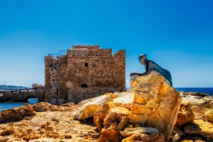 Paphos Castle with a sculpture on Cyprus Island.