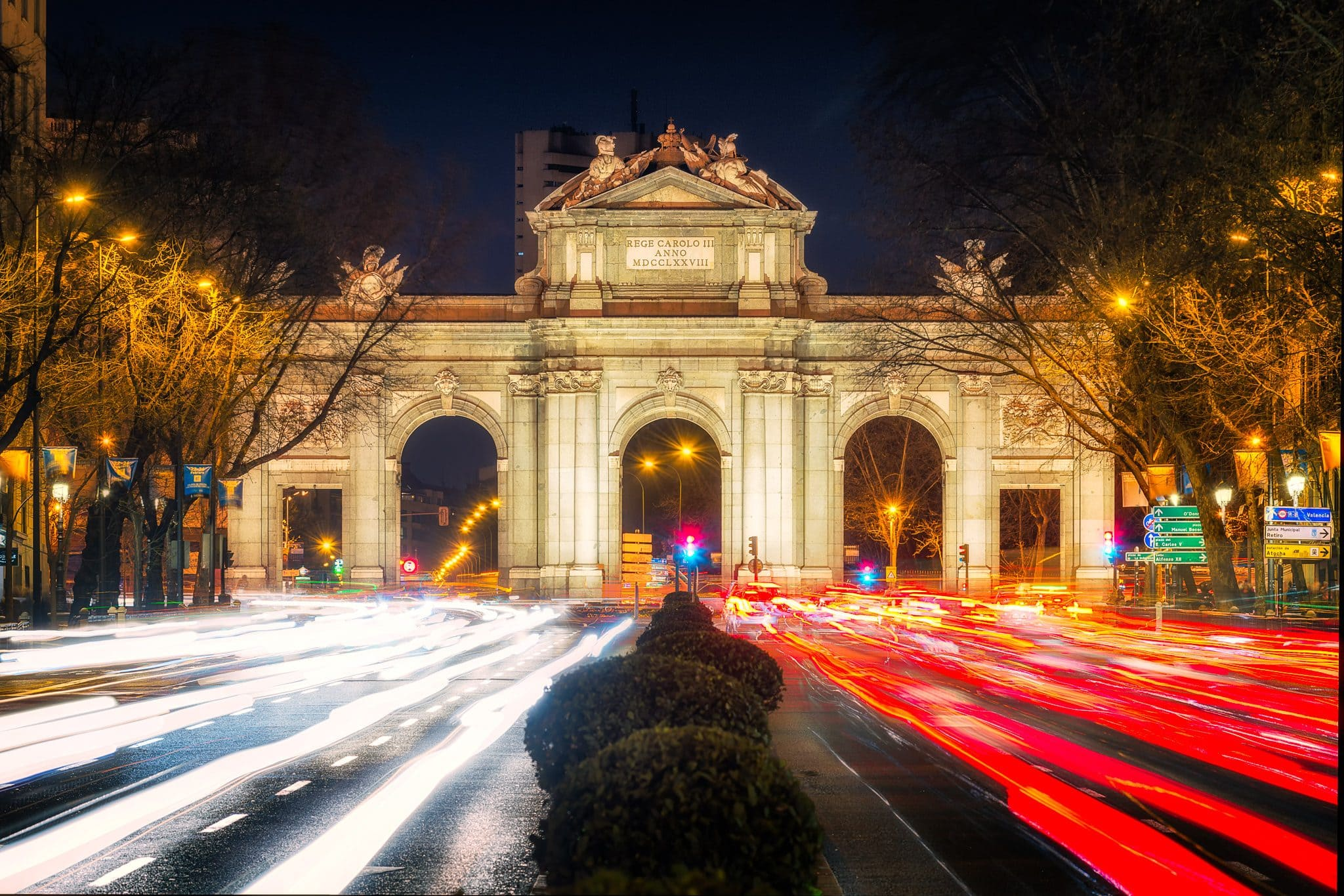 Puerta de Alcalá – A night shot with car light trails in Madrid, Spain.