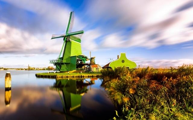 Windmills like De Gekroonde Poelenburg in Zaanse Schans in the Netherlands.