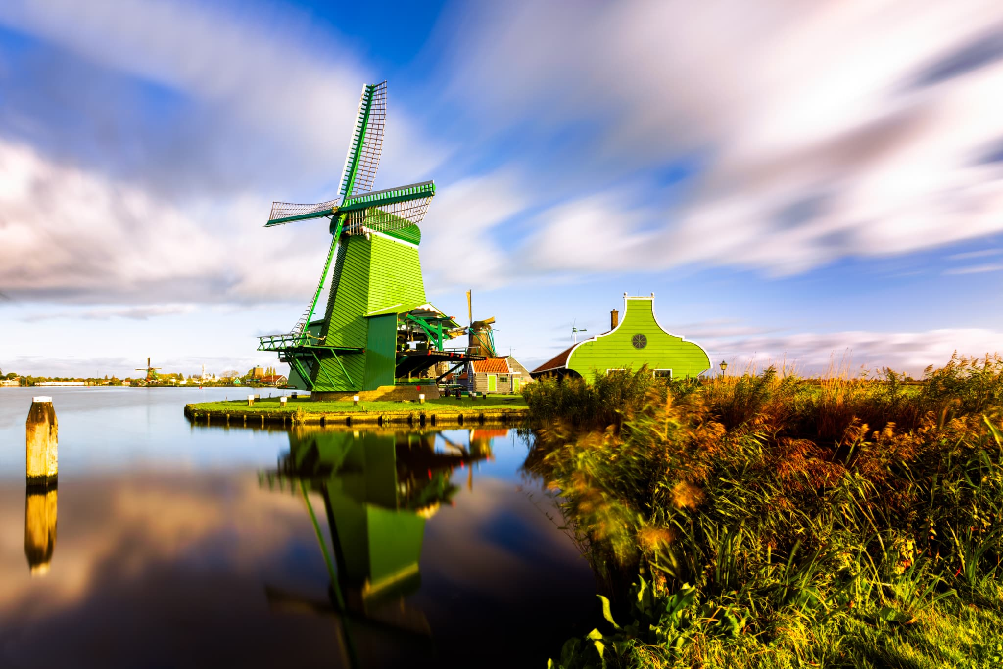 Windmills like De Gekroonde Poelenburg in Zaanse Schans in the Netherlands.