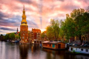 Amsterdam, Montelbaanstoren at sunset – canal view, the Netherlands.