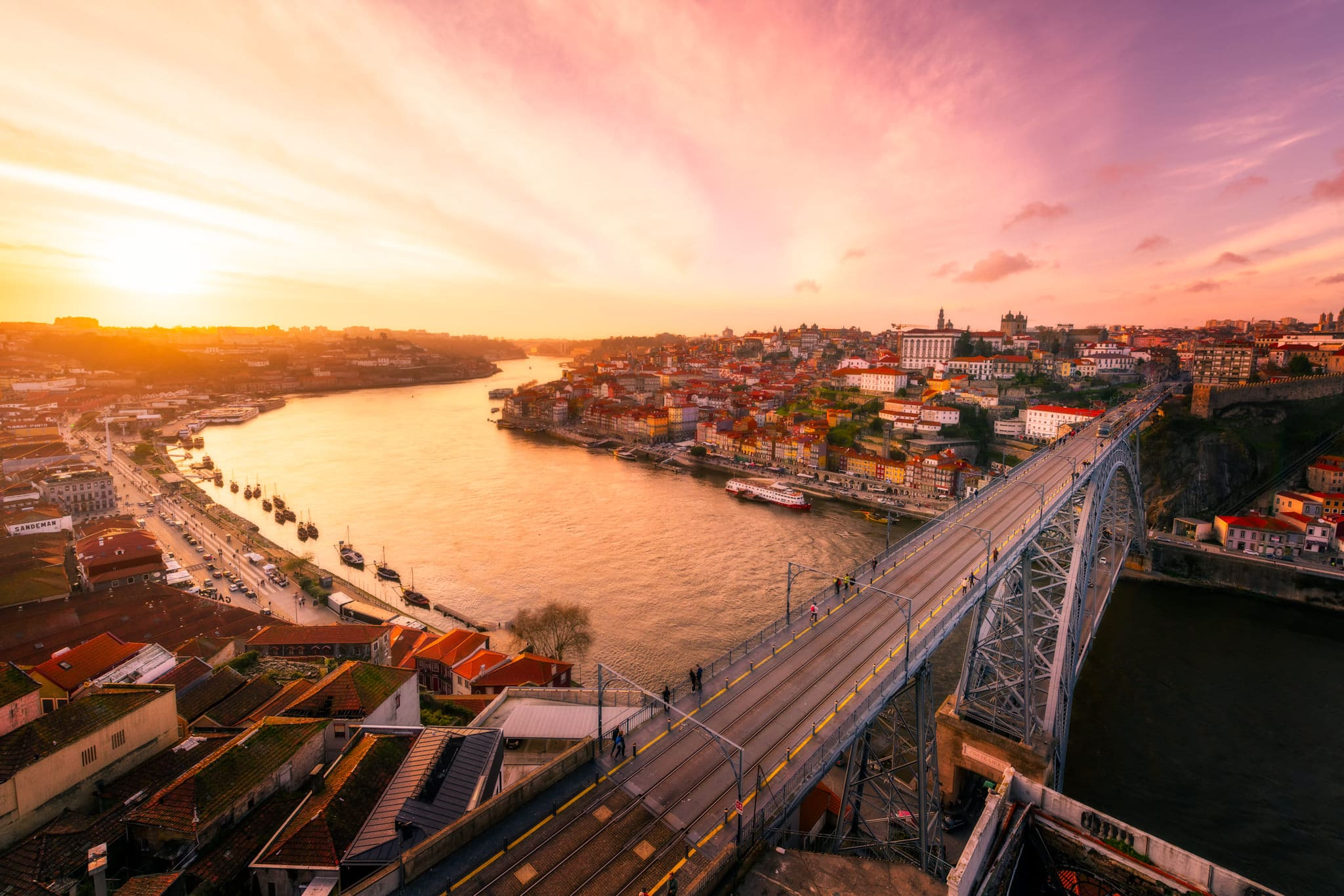 Sunset in Porto with D. Luis Bridge and city skyline, Portugal.