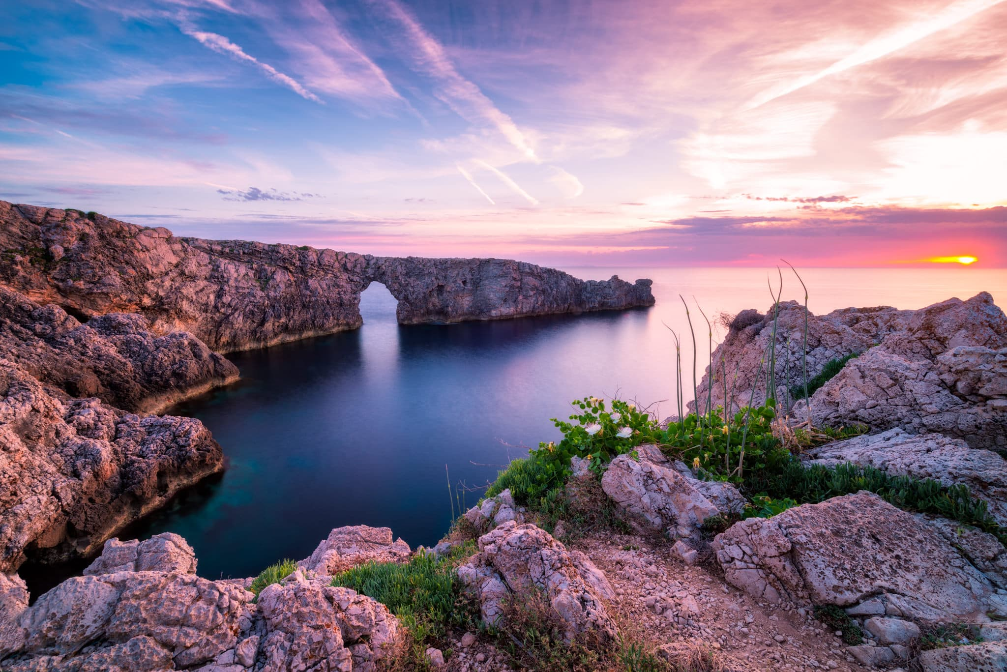 Menorca Cliffs - Pont d'en Gil bridge in the evening, Spain.
