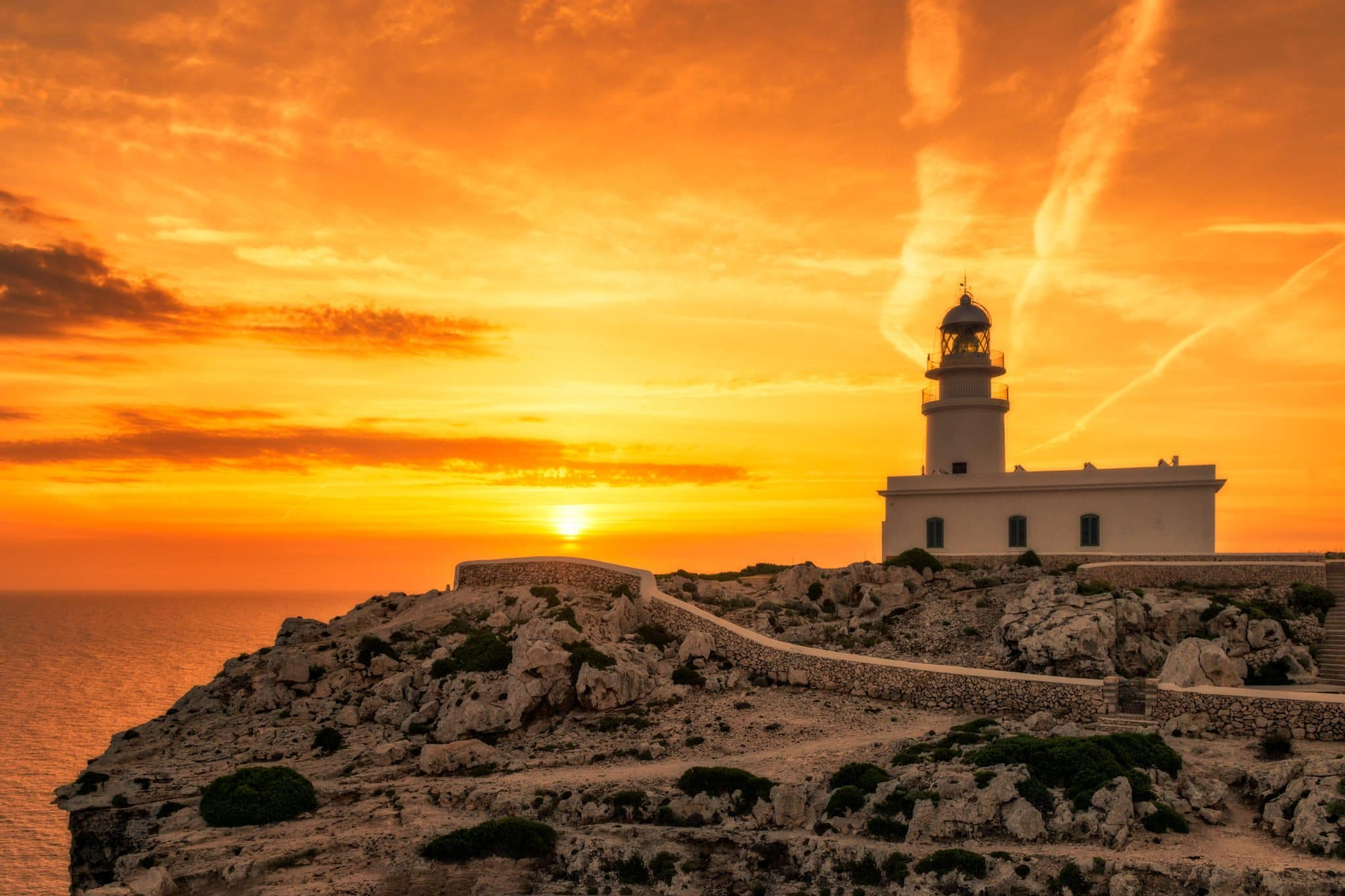 Lighthouse at Cabo de Cavalleria, Menorca during a sunrise, Spain.