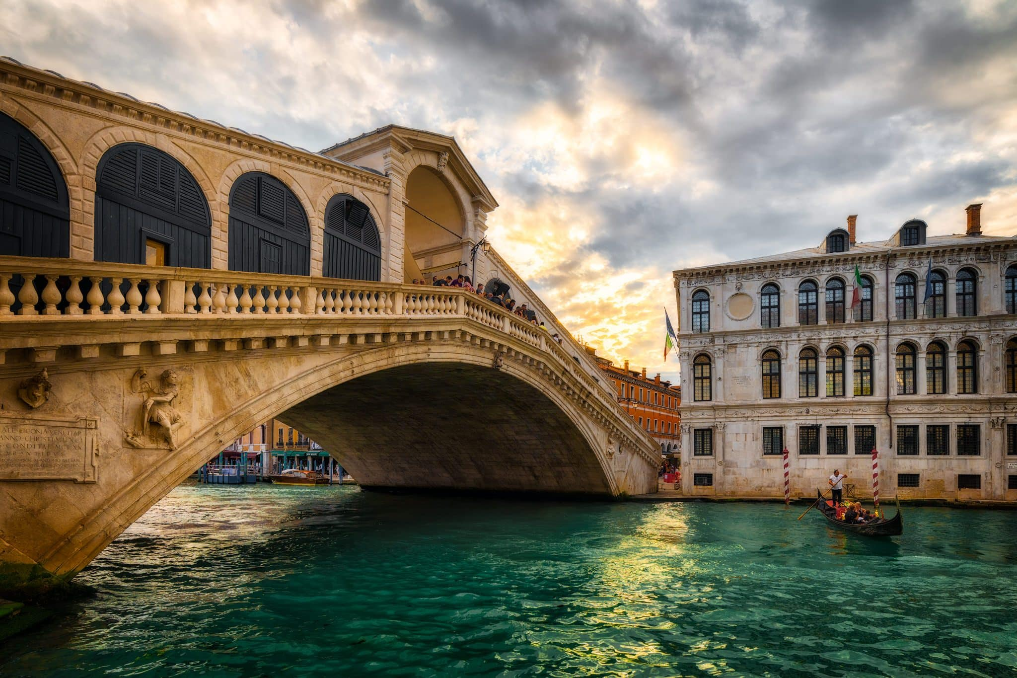 Sunset at Rialto Bridge and Gran Canal in Venice.