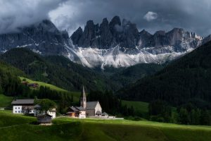 Santa Maddalena Church with Odle Mountain Group in the background. Summer in Italy.