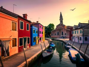 Island in the Venice Lagoon – Burano and San Martino Church with the Leaning Tower, Italy