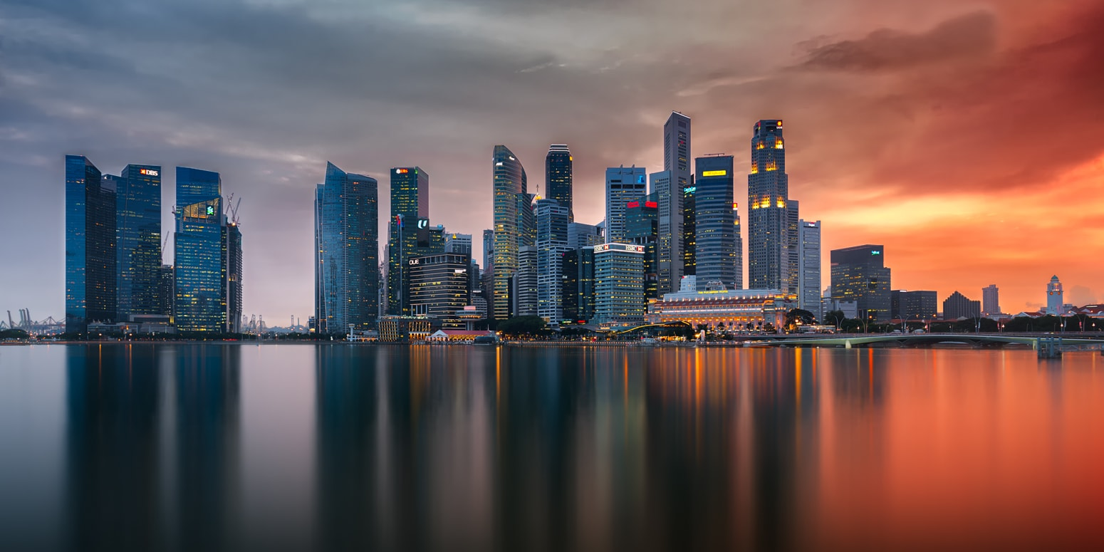 Singapore Skyline as seen from Marina Bay in the evening.