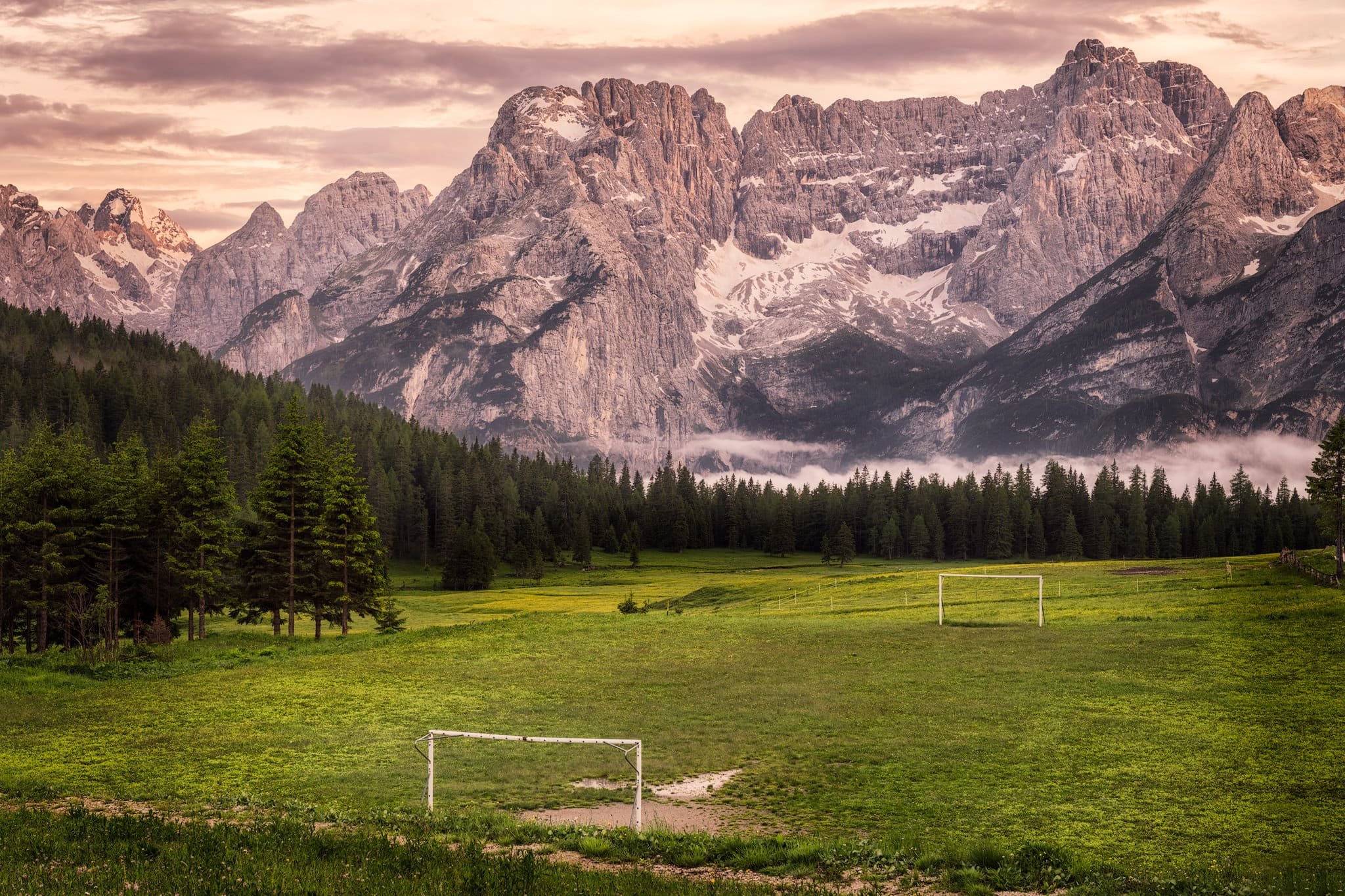 Misurina in the Dolomites – an evening view of Civetta Mountain and… a football pitch!