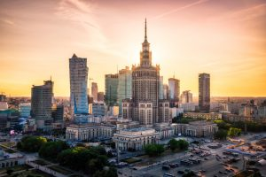 The sun setting directly behind the Palace of Culture and Science in the Warsaw Skyline