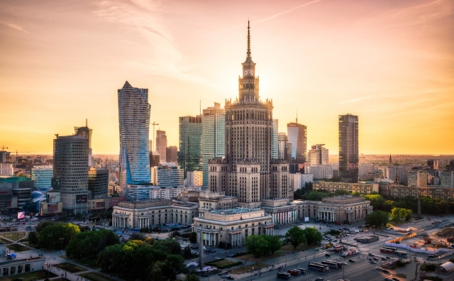 Sunset behind the Palace of Culture in the Warsaw Skyline