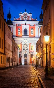 Poznan Fara at night – baroque Basilica of Our Lady of Perpetual Help, Mary Magdalene and Saint Stanislaus; Poland