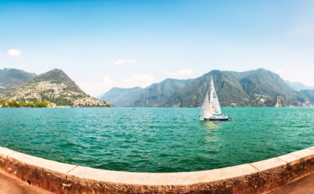 Sailing Boat on Lake Lugano in Switzerland, panorama image