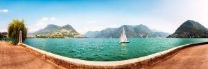 Panorama of Lugano - lake city and the Alps; Switzerland