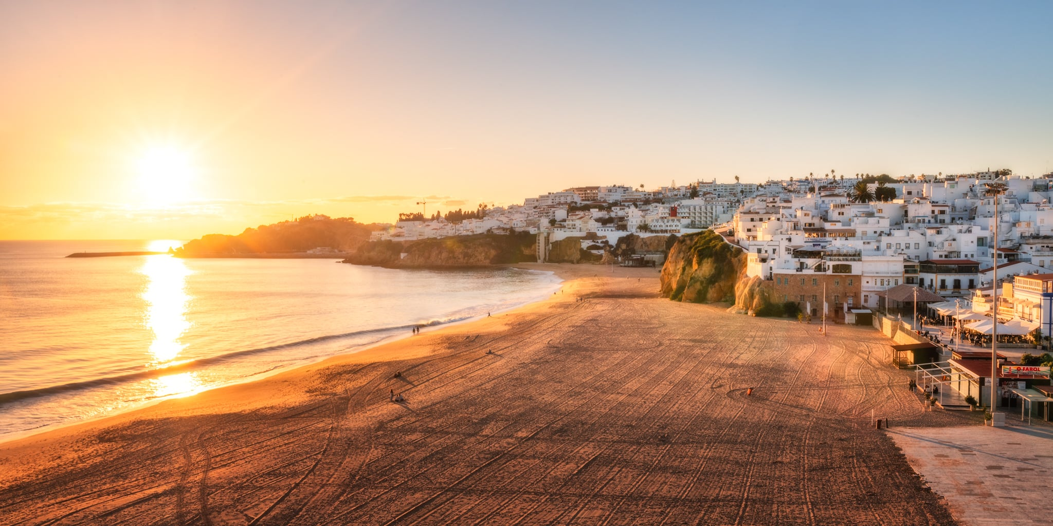 Albufeira in Algarve - panorama of the beach at sunset; Portugal